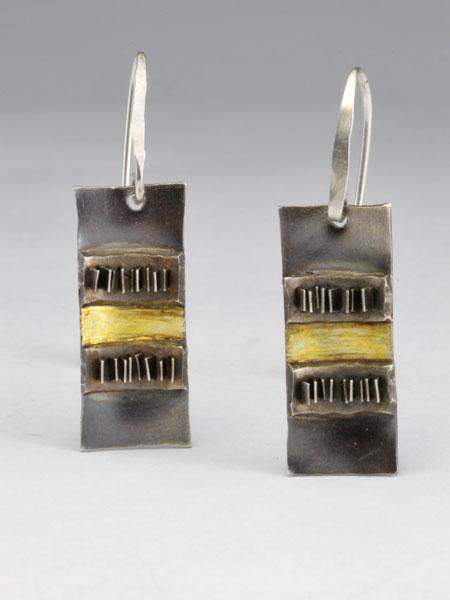 Zilveren oorbellen uit de aarde serie